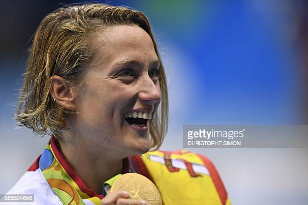 Spain's Mireia Belmonte Garcia poses on the podium with her gold medal after she won the Women's 200m Butterfly Final during the swimming event at...