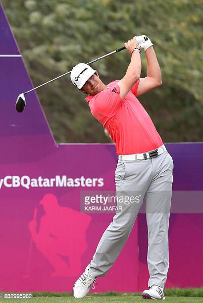 Spain's Nacho Elvira competes during the Qatar Masters golf tournament at the Doha Golf Club in Doha on January 29 2017 / AFP / KARIM JAAFAR