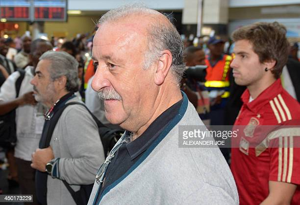 Spain's national football team coach Vicente del Bosque arrives with his team at Johannesburg airport on November 17 two days ahead of a friendly...