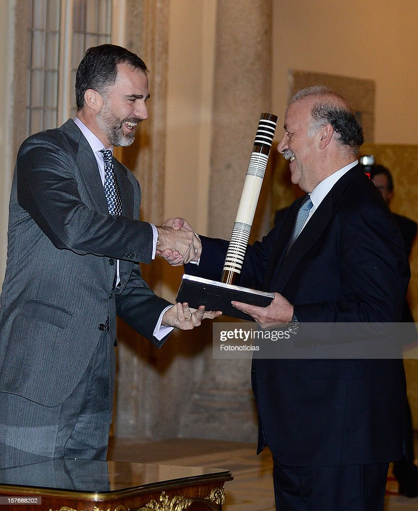 Spain's national football team coach Vicente Del Bosque (R) receives from Prince Felipe of Spain (L) the Olimpia Prize during the National Sports Awards ceremony at El Pardo Palace on December 5, 2012 in Madrid, Spain.