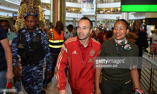 Spain's national football team midfielder Andres Iniesta arrives with his team at Johannesburg airport on November 17 two days ahead of a friendly...