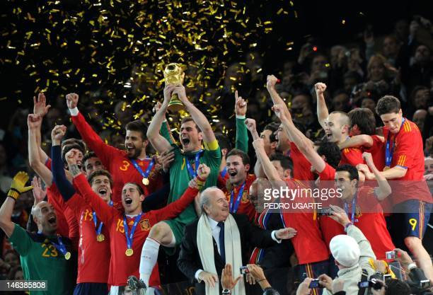 Spain's national football team players celebrate with the trophy during the award ceremony following the 2010 World Cup football final Netherlands vs...