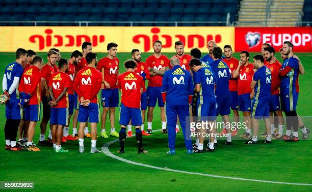 Spain's national football team players speak to their coach Julen Lopetegui during a training at the Teddy stadium in Jerusalem on October 8 a day...