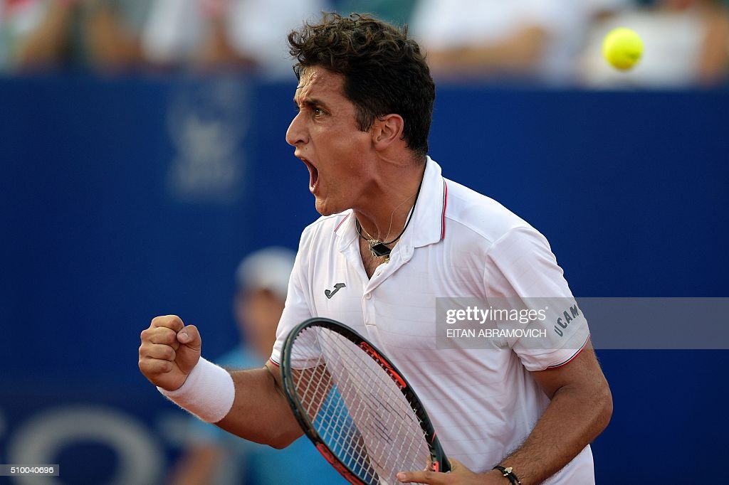 Spain's Nicolas Almagro celebrates a point against Spain's David Ferrer during their semi-final tennis match at the ATP Argentina Open in Buenos Aires, Argentina, on February 13, 2016. AFP PHOTO/EITAN ABRAMOVICH / AFP / EITAN ABRAMOVICH