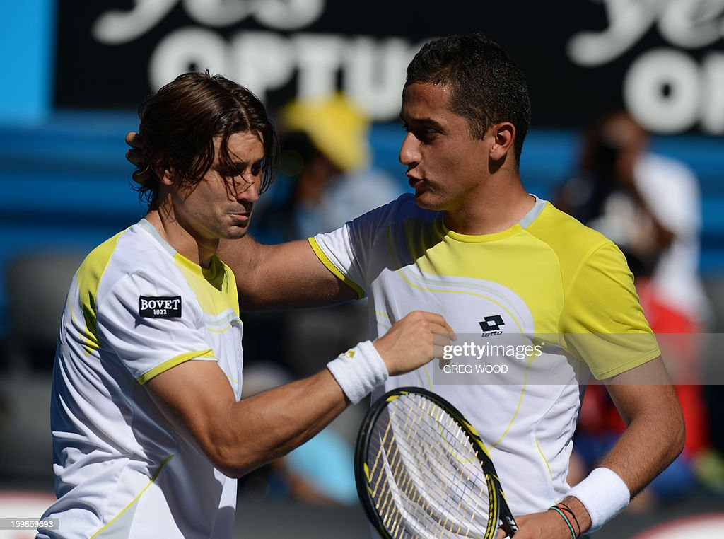 Spain's Nicolas Almagro (R) congratulates compatriot David Ferrer after his victory in their men's singles match on the nineth day of the Australian Open tennis tournament in Melbourne on January 22, 2013. AFP PHOTO/GREG WOOD IMAGE STRICTLY RESTRICTED TO EDITORIAL USE - STRICTLY NO COMMERCIAL USE