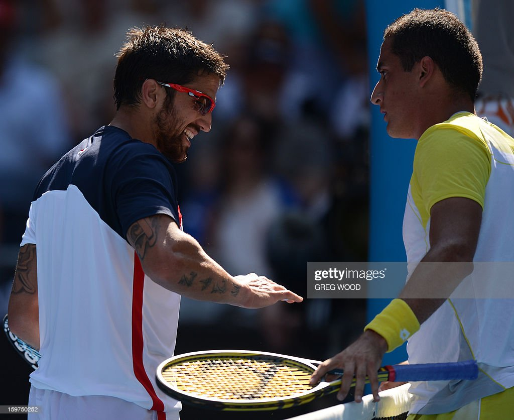 Spain's Nicolas Almagro (R) consoles Serbia's Janko Tipsarevic after he retired from their men's singles match on the seventh day of the Australian Open tennis tournament in Melbourne on January 20, 2013.