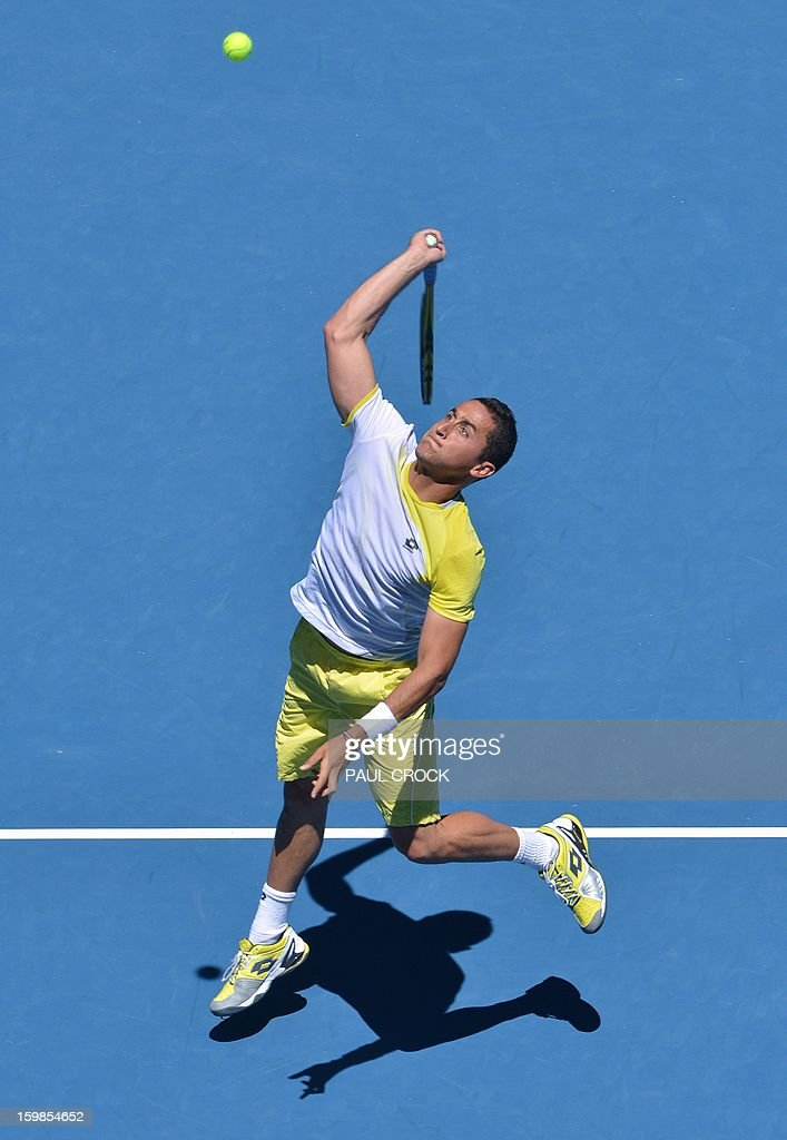 Spain's Nicolas Almagro hits a return against Spain's David Ferrer during their men's singles match on day nine of the Australian Open tennis tournament in Melbourne on January 22, 2013.