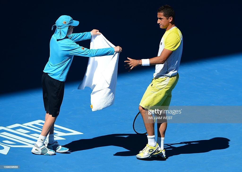 Spain's Nicolas Almagro reaches for a towel during his men's singles match against Spain's David Ferrer on day nine of the Australian Open tennis tournament in Melbourne on January 22, 2013.