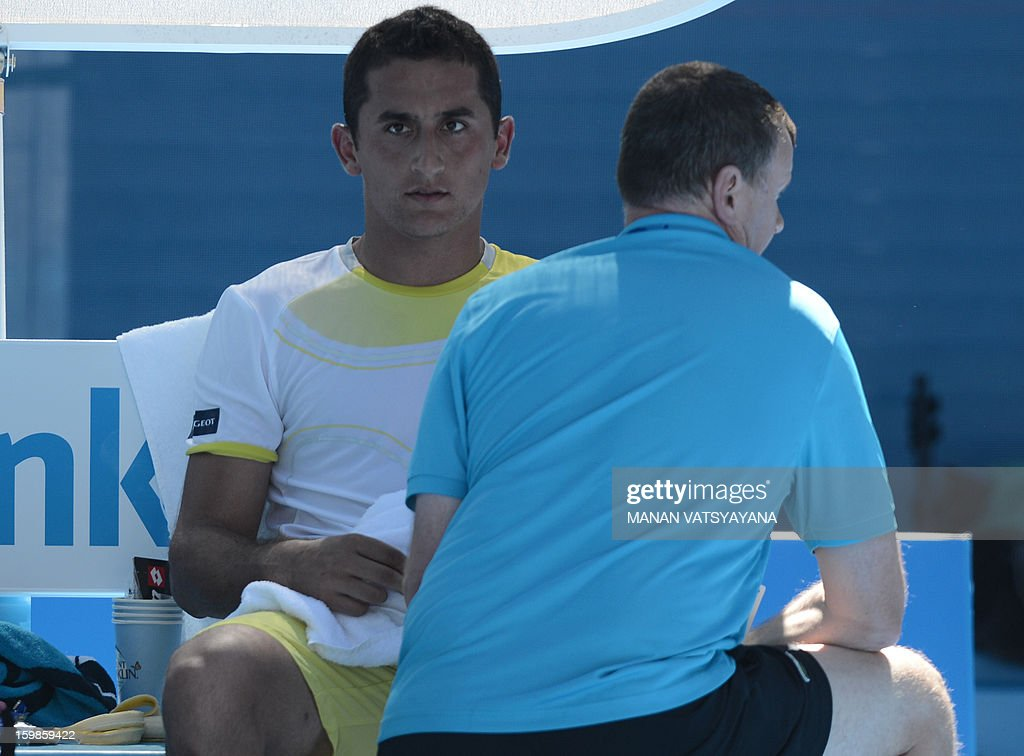 Spain's Nicolas Almagro receives treatment during his men's singles match against Spain's David Ferrer on day nine of the Australian Open tennis tournament in Melbourne on January 22, 2013.
