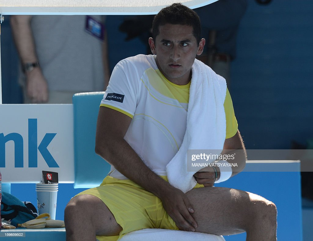 Spain's Nicolas Almagro rests during a break in his men's singles match against Spain's David Ferrer on day nine of the Australian Open tennis tournament in Melbourne on January 22, 2013. AFP PHOTO / MANAN VATSYAYANA IMAGE STRICTLY RESTRICTED TO EDITORIAL USE - STRICTLY NO COMMERCIAL USE