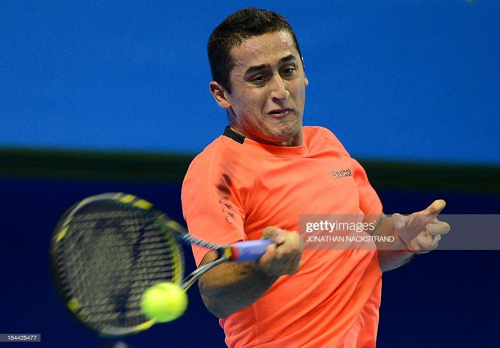 Spain's Nicolas Almagro returns the ball to Australia's Lleyton Hewitt during the quarter-final at the ATP Stockholm Open tennis tournament on October 19, 2012 in Stockholm. Almagro beats Hewitt with the score 6-1 6-4. AFP PHOTO/JONATHAN NACKSTRAND