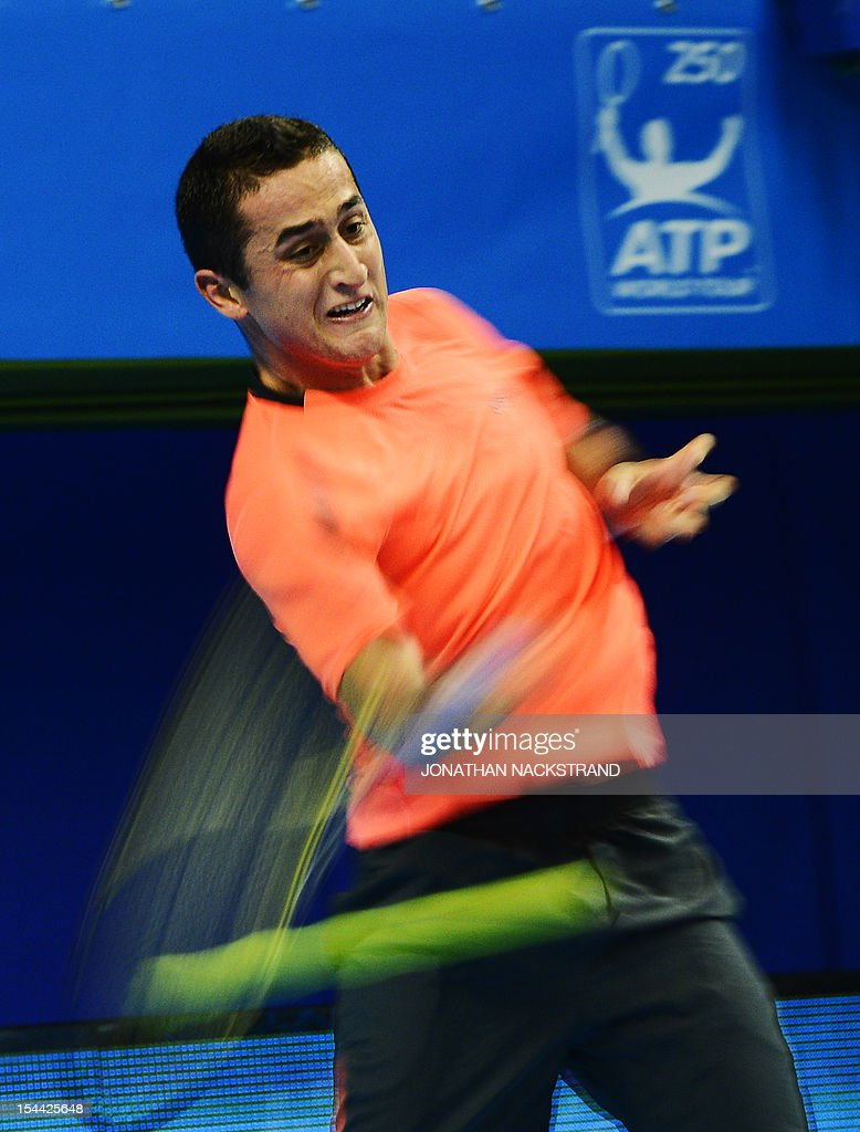 Spain's Nicolas Almagro returns the ball to Australia's Lleyton Hewitt during the quarter-final at the ATP Stockholm Open tennis tournament on October 19, 2012 in Stockholm. Almagro beats Hewitt with the score 6-1 6-4. AFP PHOTO/JONATHAN NACKSTRAND