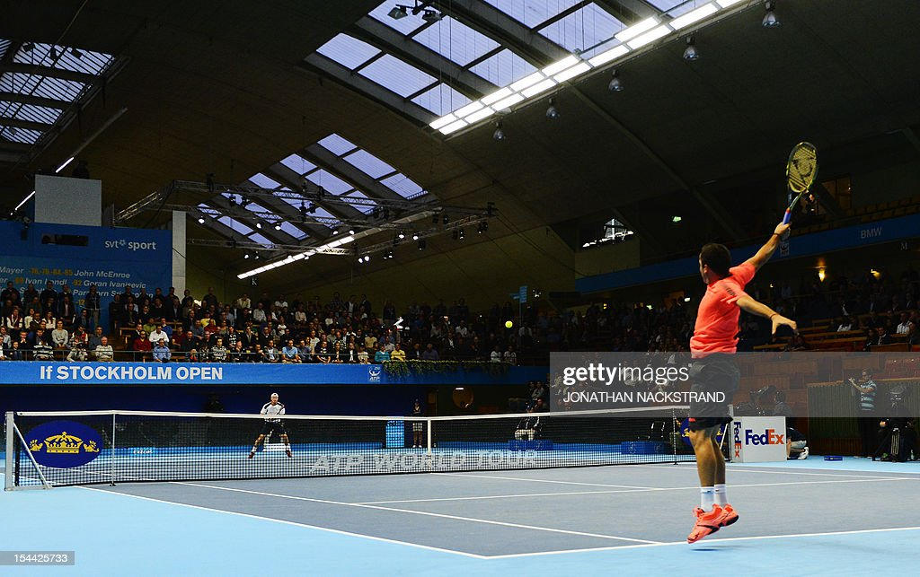 Spain's Nicolas Almagro returns the ball to Australia's Lleyton Hewitt during the quarter-finals at the ATP Stockholm Open tennis tournament on October 19, 2012 in Stockholm. Almagro beats Hewitt with the score 6-1 6-4. AFP PHOTO/JONATHAN NACKSTRAND