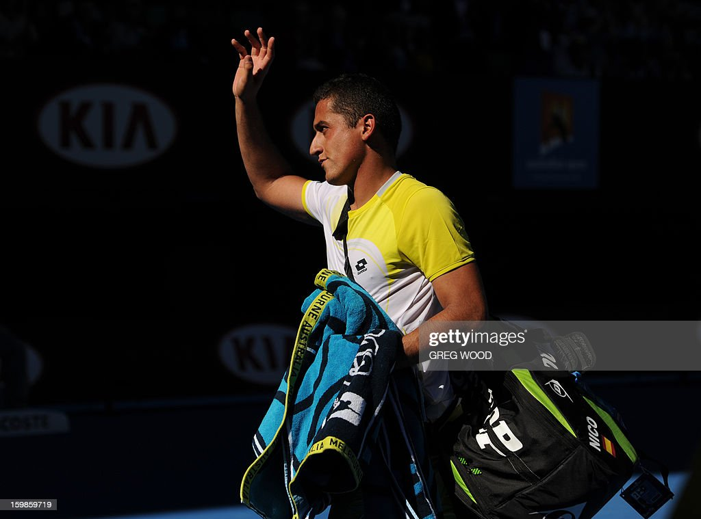 Spain's Nicolas Almagro waves to the crowd as he leaves court after his defeat to compatriot David Ferrer in their men's singles match on the nineth day of the Australian Open tennis tournament in Melbourne on January 22, 2013.