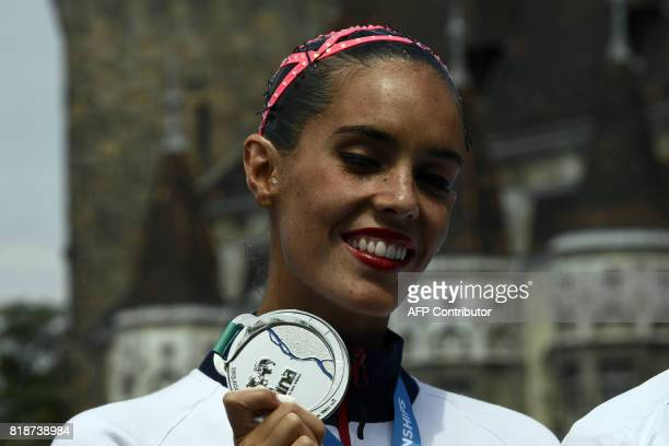 Spain's Ona Carbonell poses with the silver medal during the podium ceremony for the Women Solo free routine final during the synchronised swimming...