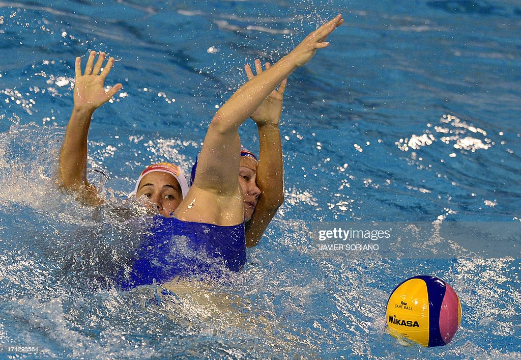 Spain's Ona Meseguer (L) vies with Russia's Olga Beliaeva (R) during the preliminary round match between Spain and Russia in the women's water polo competition at the FINA World Championships in Bernat Picornell pools in Barcelona on July 23, 2013.