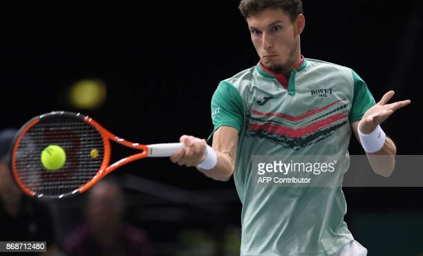 Spain's Pablo Carreno Busta returns the ball to France's Nicolas Mahut during their first round match at the ATP World Tour Masters 1000 indoor...