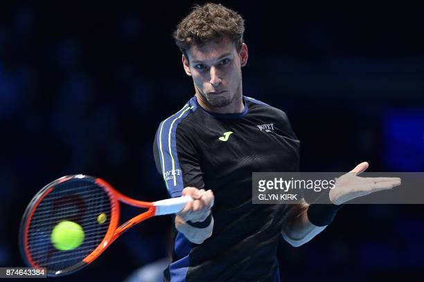 Spain's Pablo Carreno Busta returns to Austria's Dominic Thiem during their men's singles roundrobin match on day four of the ATP World Tour Finals...