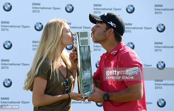 Spain's Pablo Larrazabal and his girlfriend Gala Ortin kiss the winner trophy during the winner ceremony of the BMW International Open golf...