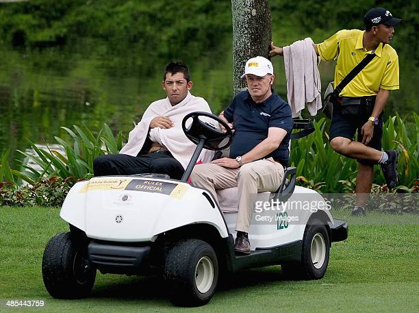 Spain's Pablo Larrazabal wraps a towel around himself after jumping into a water hazard in an attempt to avoid a hornet attack during round two of...