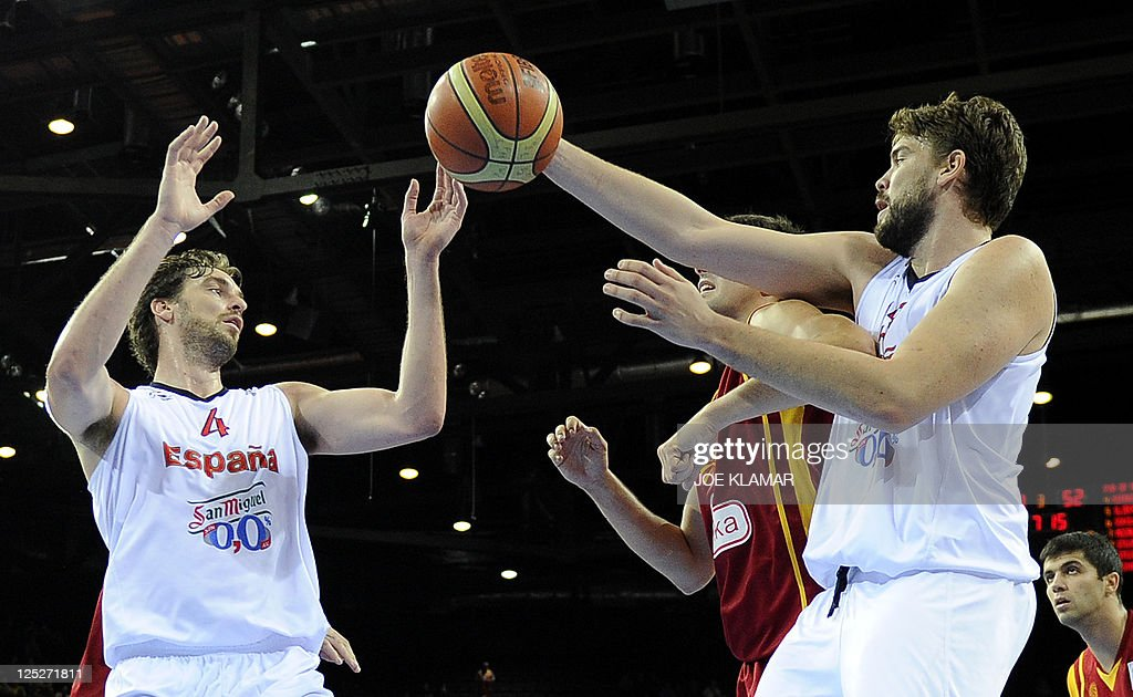 Spain's Pau and Marc Gasol pass a ball during the semifinal match between Spain and Macedonia during the EuroBasket2011 in Kaunas on September 16...