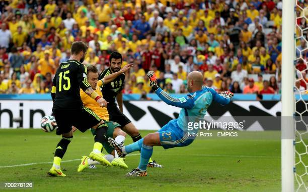 Spain's Pepe Reina Sergio Ramos and Raul Albiol battle for the ball with Australia's Adam Taggart