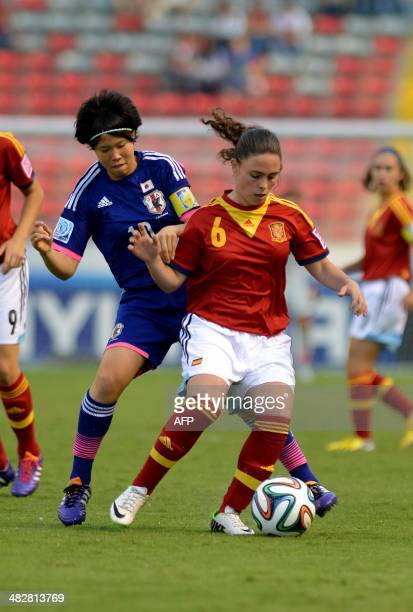 Spain's Pilar Garrote vies for the ball with Japan's Hina Suguita during their FIFA U17 Women's World Cup Costa Rica 2014 final match at the National...
