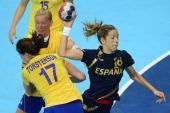 Spain's pivot Begona Fernandez Molinos shoots during the women's preliminary Group B handball match Spain vs Sweden for the London 2012 Olympics...