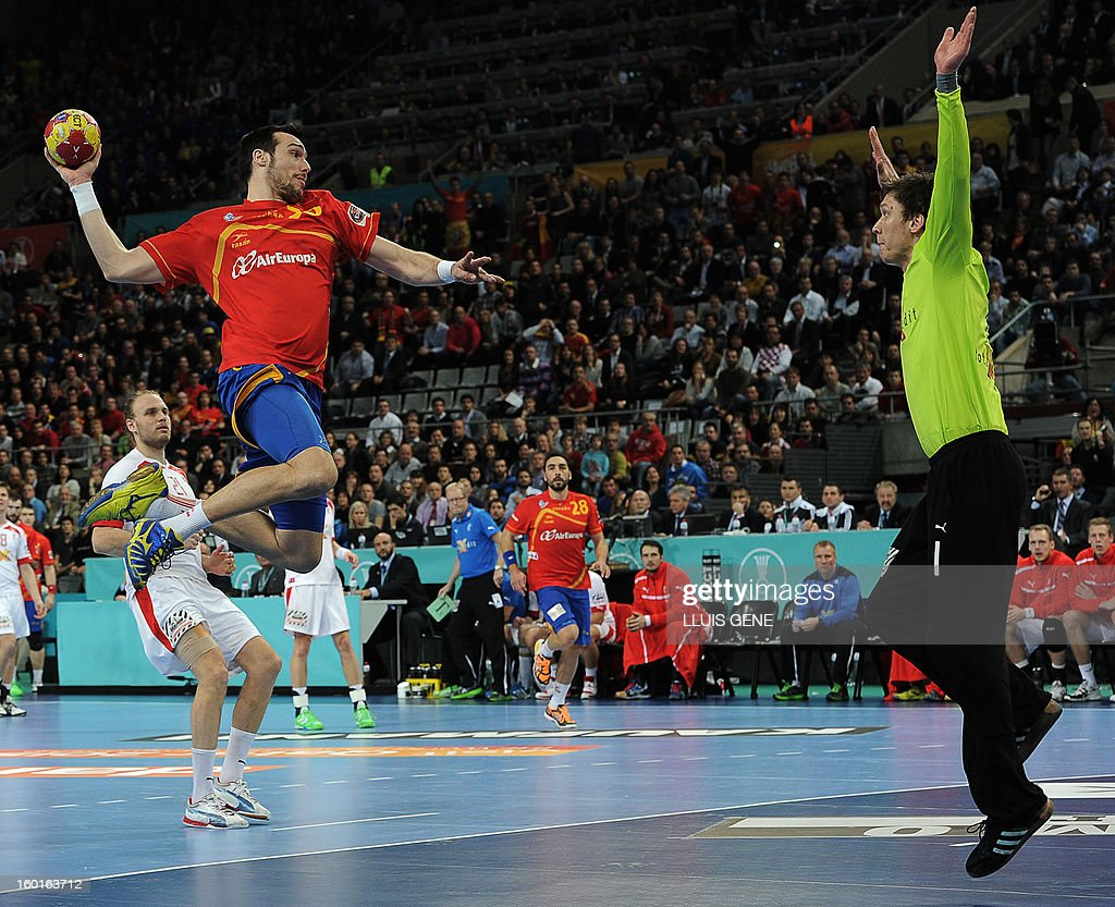 Spain's pivot Gedeon Guardiola (L) shoots at Denmark's goalkeeper Niklas Landin during the 23rd Men's Handball World Championships final match Spain vs Denmark at the Palau Sant Jordi in Barcelona on January 27, 2013. AFP PHOTO/ LLUIS GENE