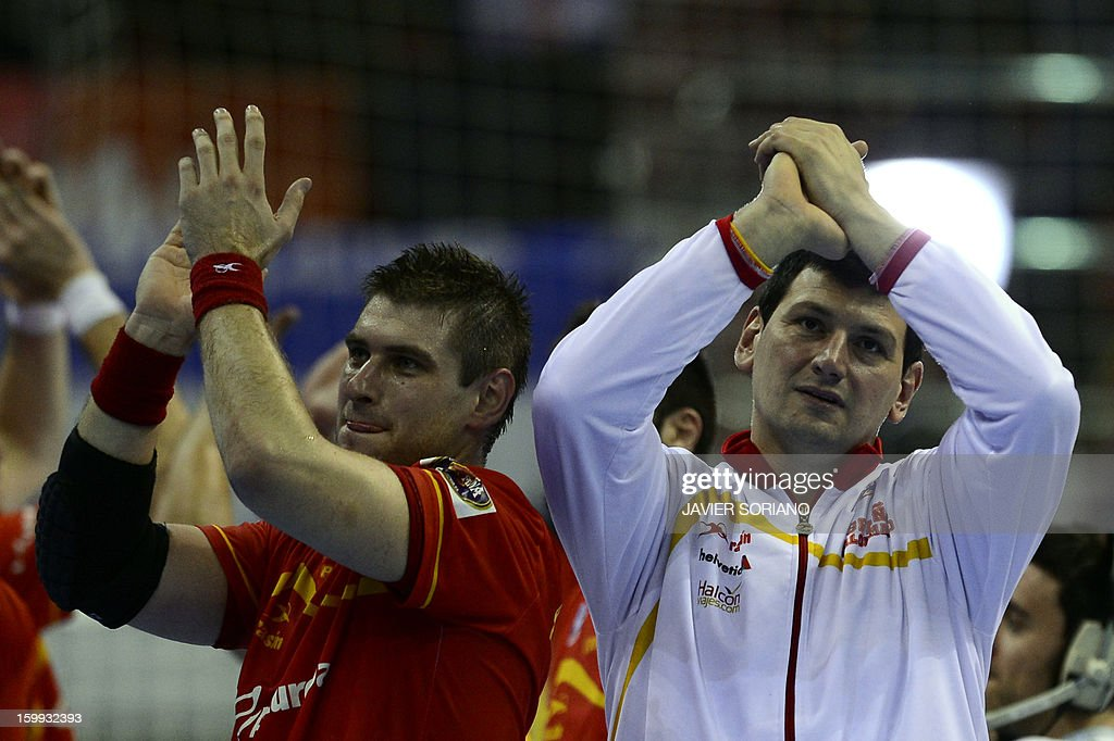 Spain's pivot Julen Aguinagalde and Spain's goalkeeper Arpad Sterbik celebrate their victory at the end of the 23rd Men's Handball World...