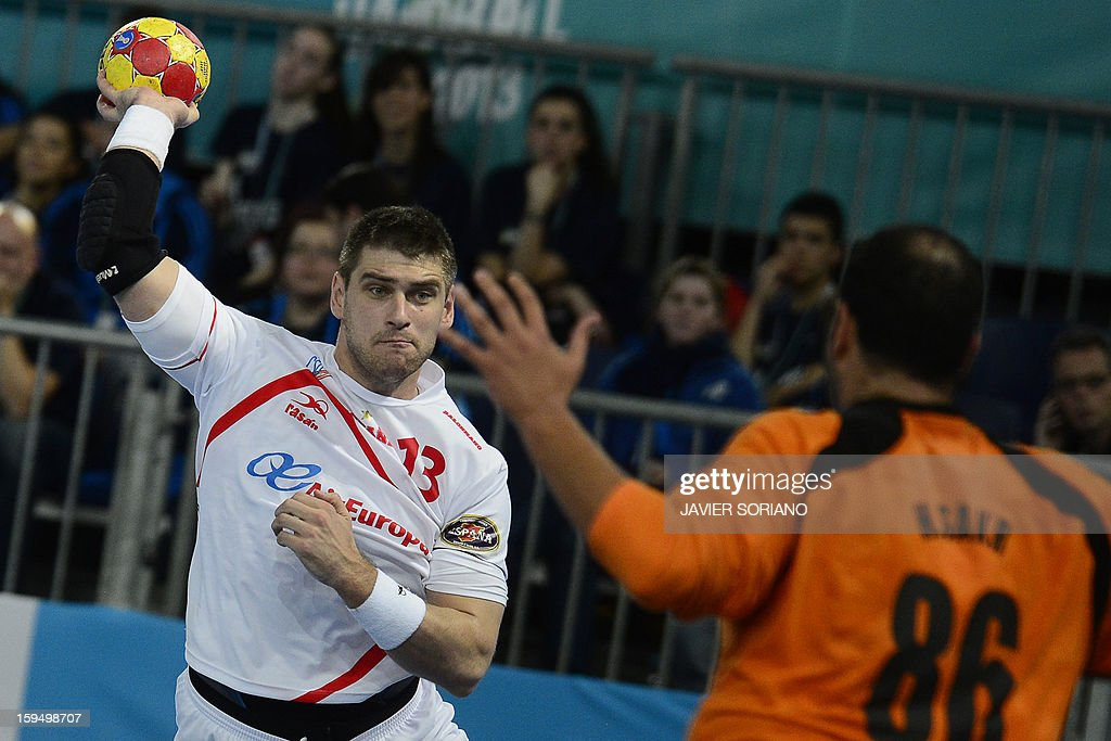 Spain's pivot Julen Aguinagalde (L) vies with Egypt's goalkeeper Hady Mohamed (R) during the 23rd Men's Handball World Championships preliminary round Group D match Egypt vs Spain at the Caja Magica in Madrid on January 14, 2013.