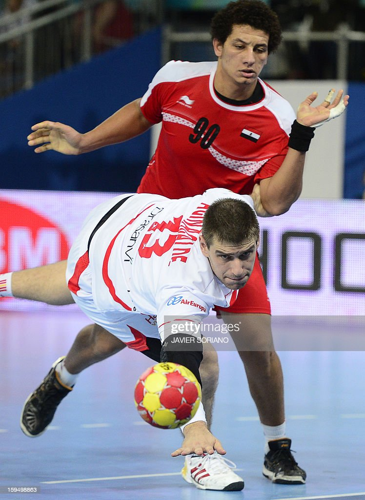 Spain's pivot Julen Aguinagalde (Front) vies with Egypt's leftback Ali Zein during the 23rd Men's Handball World Championships preliminary round Group D match Egypt vs Spain at the Caja Magica in Madrid on January 14, 2013.