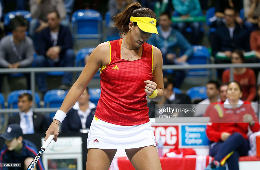 Spain's player Garbine Muguruza reacts during the tennis match of the first round of the International Tennis Federation Cup between Serbia and Spain on February 6, 2016 in Kraljevo. / AFP / STRINGER