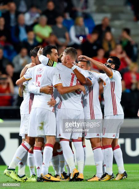 Spain's players celebrate after a goal scored by Spain's Alvaro Morata during the FIFA World Cup 2018 qualification football match between...