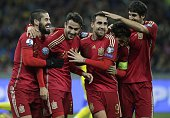 Spain's players celebrate after scoring during the Euro 2016 qualifying football match between Ukraine and Spain at Olympiysky stadium in Kiev on...