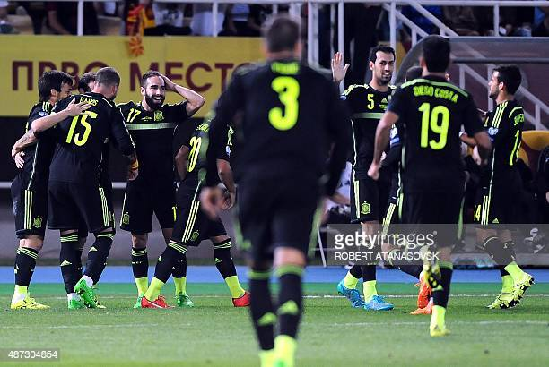 Spain's players celebrate after scoring during the Euro 2016 Group C qualifying football match between Macedonia and Spain at the Filip II Arena...