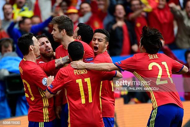 Spain's players celebrate after Spain's defender Gerard Pique scored the opening goal during the Euro 2016 group D football match between Spain and...