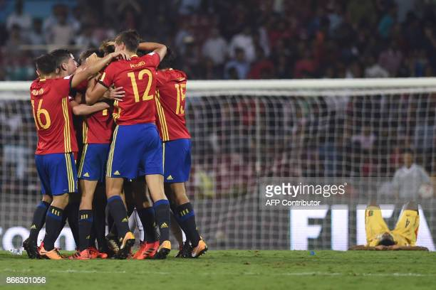 Spain's players celebrate after winning their semifinal football match against Mali during the FIFA U17 World Cup at the DY Patil stadium in Navi...