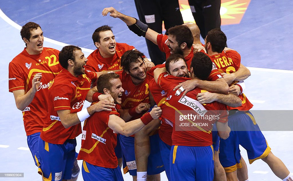 Spain's players celebrate at the end of the 23rd Men's Handball World Championships quarterfinal match Spain vs Germany at the Pabellon Principe...