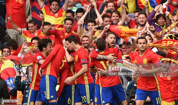 Spain's players celebrate their goal during the Euro 2016 group D football match between Spain and Czech Republic at the Stadium Municipal in...