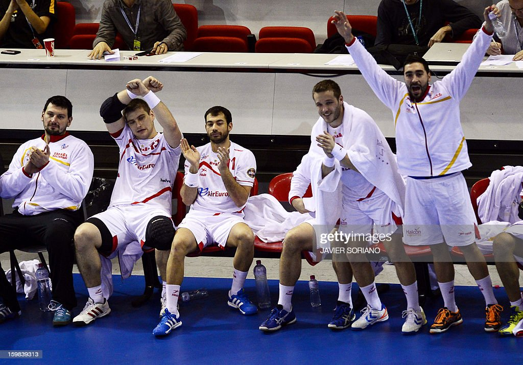 Spain's players celebrate their victory at the end of the 23rd Men's Handball World Championships round of 16 match Serbia vs Spain at the Pabellon Principe Felipe in Zaragoza on January 21, 2013. Spain won the match 31-20.