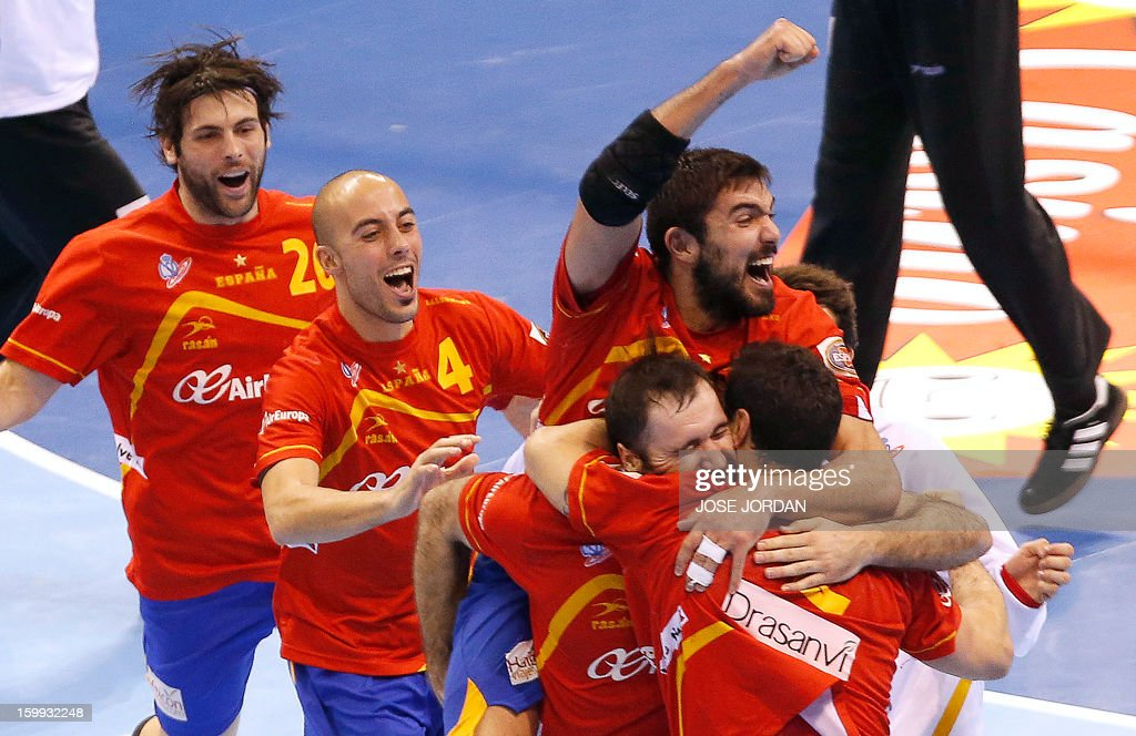Spain's players celebrate their victory at the end of the 23rd Men's Handball World Championships quarterfinal match Spain vs Germany at the Pabellon...