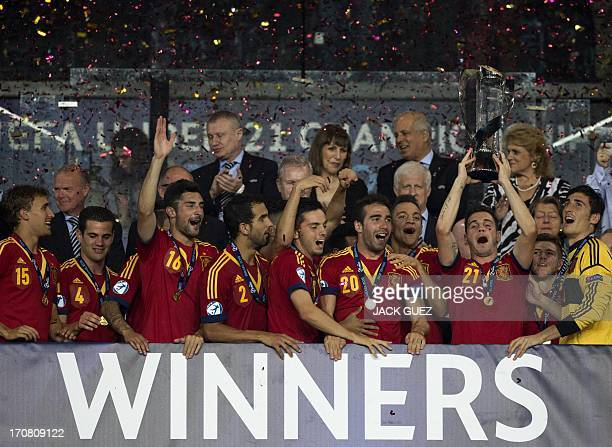 Spain's players celebrate with the trophy after beating Italy in their 2013 UEFA U21 Championship final football match at Teddy Stadium in Jerusalem...