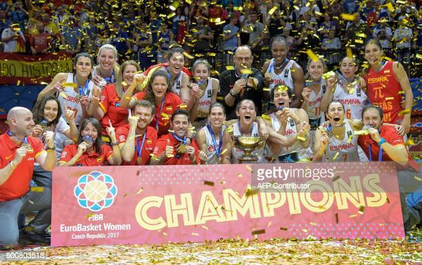 Spain's players celebrate with the trophy during the winner's ceremony after winning the FIBA EuroBasket 2017 women's final match between Spain and...