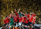 Spain's players hold the trophy during the award ceremony following the 2010 FIFA football World Cup between the Netherlands and Spain on July 11...