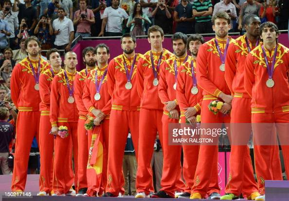 Spain's players pose on the podium after winning the silver medal in the London 2012 Olympic Games men's basketball competition at the North...