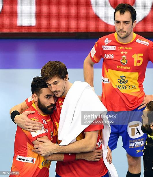 Spain's players react after losing the final match of the Men's 2016 EHF European Handball Championship between Germany and Spain in Krakow on...