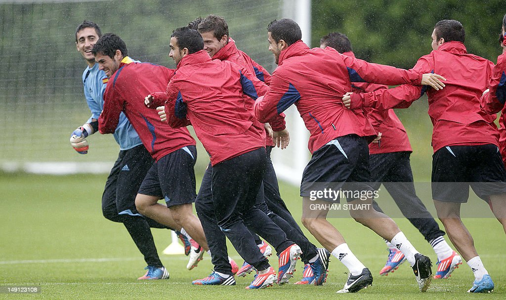 Spain's players run during a training session at the University of Strathclyde Sportsground in Glasgow Scotland on July 23 2012 Spain will play its...