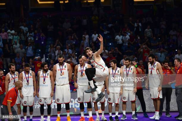 Spain`s players stand on the podium with their third placed medals after winning the FIBA Eurobasket 2017 men`s bronze medal basketball match against...