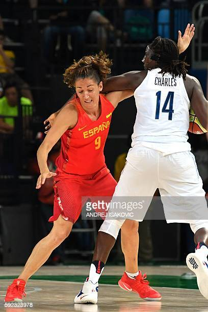 Spain's point guard Laia Palau fouls USA's centre Tina Charles during a Women's Gold medal basketball match between USA and Spain at the Carioca...